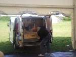 Petrit and Michael unloading the Miraculous Relic Image from the van