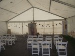 Image of the inside of the marquee with bunting and rows of empty chairs - the Miraculous Relic Image display is ready