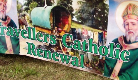 Travellers Catholic Renewal sign featuring bow-top caravan and religious figure