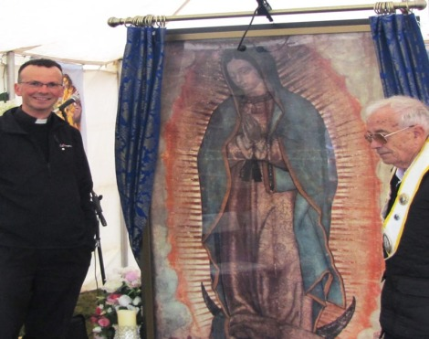 Father Philip Conner and Guardian Dick standing before the Miraculous Relic Image