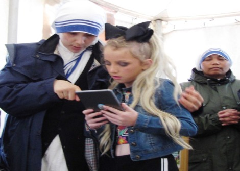 Two Sisters of Charity helping young girl with information