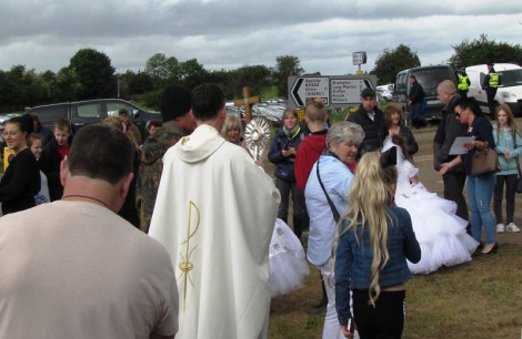 Father Philip leading Blessed Sacrament Procession