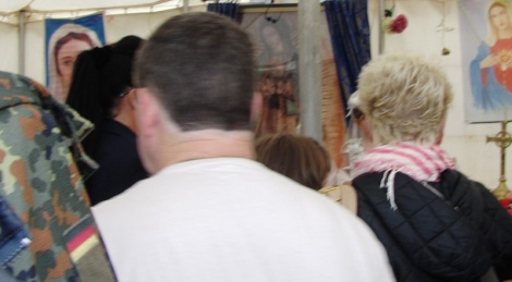 People venerating the Miraculous Relic Image in the Mission tent