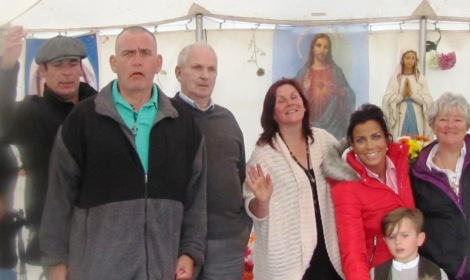 Members of the Travellers Catholic Renewal Community wave goodbye from the Mission tent.