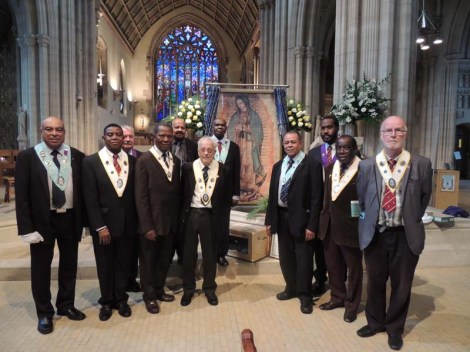 Knights of St Columba standing before Relic Image