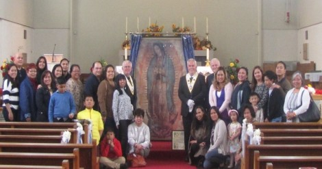 Members of the Filipino Community gather before the Miraculous Relic Image