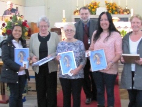 The Flower Girls receive their enrolment certificates