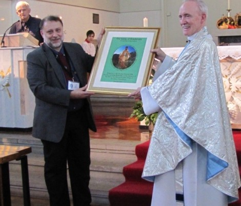Guardian Michael makes the presentation to Father Michael